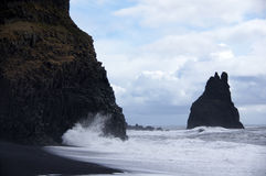Waves and basalt at Reynisdrangar in Vik Royalty Free Stock Photos