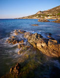 Waves bathing a rock. Near Calvi, Corsica Royalty Free Stock Photos