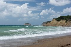 Waves in a bay of the Aegean Sea in Rhodes. In summer day stock images