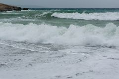 Waves in a bay of the Aegean Sea in Rhodes. In summer day royalty free stock photos