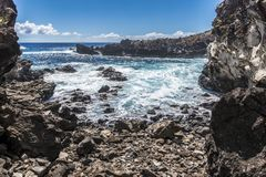 Waves in the bay of Ana Kai Tangata cave royalty free stock image