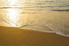 Waves on the Beach. Waves washing up on the sand at sunset Stock Images