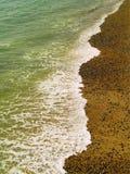 Waves on Beach. Gentle wave on the beach, Brighton UK Stock Image