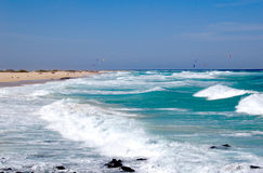 Waves on the beach. Playa de Corralejo on Fuerteventura, Canaries. One of the most beautiful beaches in the world, windsurfing paradise Stock Image