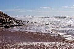 Waves on the beach Areia Branca. West coast of Portugal. Waves on the beach Areia Branca. Lourinha, west coast of Portugal stock photography