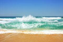 Waves on the beach in Suances, Spain. Beach with beautiful waves and blue sky in Suances, Spain stock photo