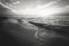Waves on beach in black and white Royalty Free Stock Photo