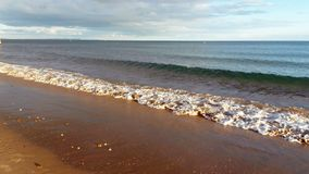 Waves on the beach in Bournemouth, Dorset, UK. Royalty Free Stock Images