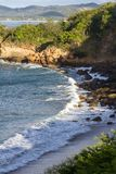 Waves at the beach. Close up of a section of beach in Playa Redonda, Nicaragua with waves crashing onto the rocks in this protected bay stock image