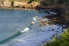 Waves at the beach. Close up of a section of beach in Playa Redonda, Nicaragua with waves crashing onto the rocks in this protected bay stock photography