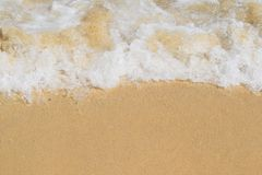Waves on a beach stock photography