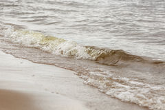 Waves on beach close up Royalty Free Stock Images