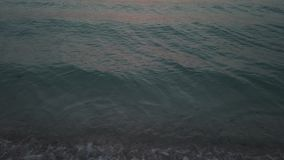 WAVES OF BEACH IN THE EVENING stock video footage