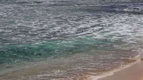 Waves and beach. Beach on Makaha Bay -  Oahu, Hawaii stock footage