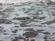 Waves. At the beach near evening in summer royalty free stock photos