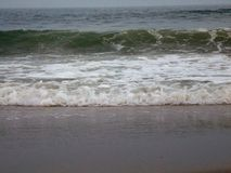 Waves. At the beach near evening in summer royalty free stock image