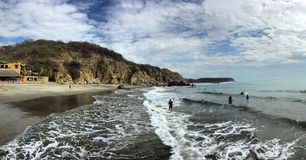 Waves beach panoramic sand rocky. Pacific beach sunny Royalty Free Stock Image