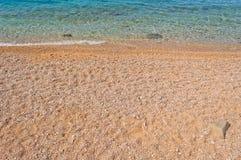 Waves on the beach of Podgora, Croatia stock photo