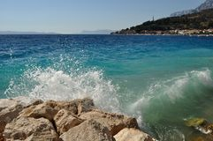 Waves on beach in Podgora, Croatia Royalty Free Stock Photography