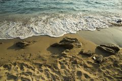 Waves beach sand afternoon in Mytikas Preveza Greece Stock Photography