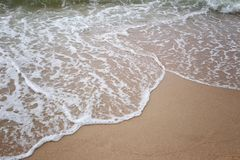 Waves on beach of sea tropics in a day time. Waves on beach of sea tropics in a day time for design concept or presenting in your work Stock Photography