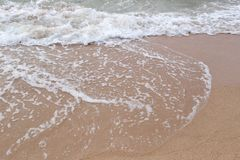Waves on beach of sea tropics in a day time. Waves on beach of sea tropics in a day time for design concept or presenting in your work Royalty Free Stock Image