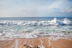 Waves on the beach. Small waves wash the beach royalty free stock photos