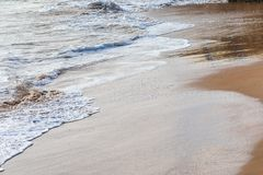 Waves on the beach on a sunny day and calm sea. stock photography