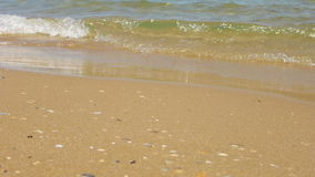 Waves at the beach on a sunny summer day Stock Photography