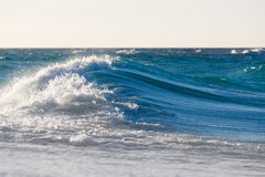 Waves on the beach of a tropical sea Stock Photos