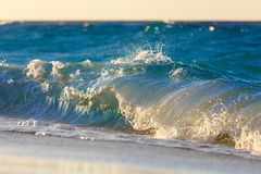 Waves on the beach of a tropical sea on sunset Stock Photo