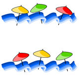 Waves and beach umbrellas Stock Images