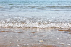 Waves on the beach. View of waves from the sea onto the beach in the foreground, with the horizon in the distance Stock Photo