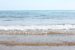 Waves on the beach. View of waves from the sea onto the beach in the foreground, with the horizon in the distance Stock Photos