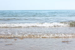 Waves on the beach. View of waves from the sea onto the beach in the foreground, with the horizon in the distance Royalty Free Stock Photo