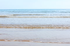 Waves on the beach. View of waves from the sea onto the beach in the foreground, with the horizon in the distance Stock Photography
