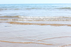 Waves on the beach. View of waves from the sea onto the beach in the foreground, with the horizon in the distance Stock Images