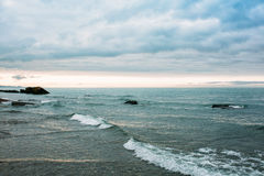The waves beat against the rocks. Black sea Stock Photos