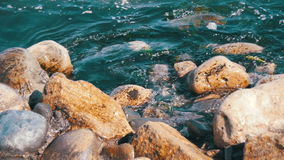 Waves Beat Against the Rocks at Sea in Slow Motion stock video footage