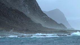 Waves beat against rocks and stones in Norway. Shevelev. stock footage