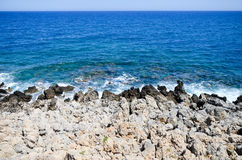 Waves beat against the rocky shore Royalty Free Stock Photo