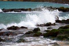 Waves beat rocky shore Stock Image