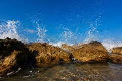 Waves are beating against stones royalty free stock photo