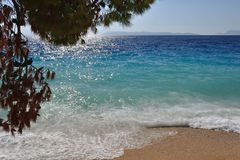 Waves on beautiful beach with sand. Podgora, Croatia Stock Images
