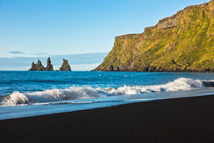Waves at beautiful black volcanic sand beach in Vik at sunrise Stock Photos