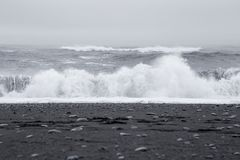 Waves in the beautiful volcanic black sand beach. Stock Photography