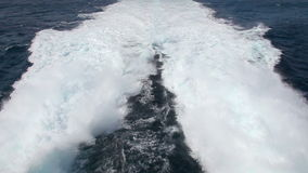 Waves behind fast motorboat stock video