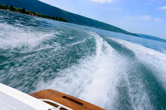 Waves behind a motorboat Stock Image