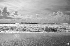 The waves. The besant nagar sea shore of chennai in black and white Royalty Free Stock Photos