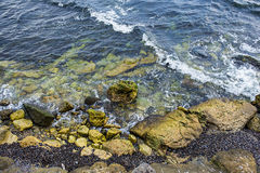 Waves and big rocks in the Black sea. Big rocks in the Black sea Royalty Free Stock Photos
